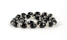 Halskette der schwarzen Steine Stockbild