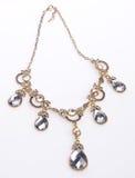 Halskette, Halskette auf Hintergrund Lizenzfreie Stockfotografie