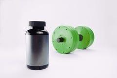 Haltères et suppléments nutritionnels pour le bodybuilding Photographie stock