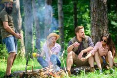 Halt for snack during hiking. Camping and hiking. Company friends relaxing and having snack picnic nature background. Great weekend in nature. Company hikers stock images