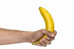 Halten der Banane Stockfotografie