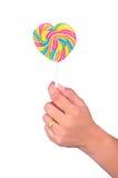 Halten der Süßigkeit lizenzfreie stockfotos