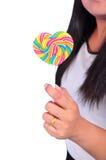 Halten der Süßigkeit stockbilder