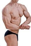 Halterofilista novo que dobra os músculos Imagem de Stock Royalty Free