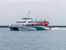 Halunder Jet catamaran on its way to Helgoland harbour Royalty Free Stock Images