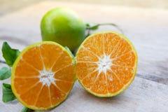 Halv apelsin och apelsin Fotografering för Bildbyråer