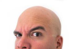 Halv framsida av den skalliga mannen i vit bakgrund Royaltyfri Fotografi