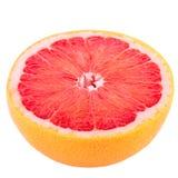 Halv grapefrukt som isoleras på vit bakgrund med den snabba banan Fotografering för Bildbyråer