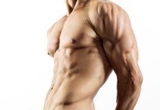 Halv naken sexig kropp av den muskulösa idrotts- idrottsmannen Royaltyfria Bilder