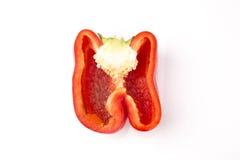 Halv röd peppar som isoleras på vit bakgrund Arkivfoto