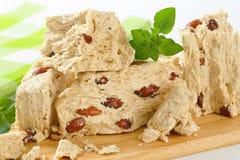 Halva with almonds. Pieces of Greek halva with almonds Stock Photos