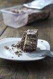 Halva with almonds and raisins on plate Stock Photos