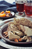 Halva with almonds Stock Photos