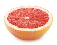 Halva av grapefrukten som isoleras på vit bakgrund Arkivfoton