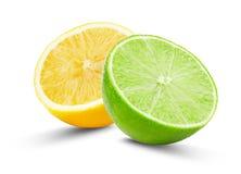 Halva av limefrukt och citronen som isoleras på den vita bakgrunden royaltyfria foton