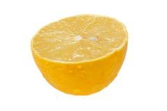 Halva en citron på isolerad bakgrund Arkivbild