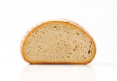 Halva en släntra av kontinentalt bröd royaltyfria foton