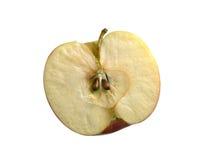 Halva ett äpple på en vitbakgrund Arkivbild