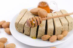 Halva with honey Stock Photography