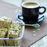 Halva pistachio and cup of coffee Royalty Free Stock Photo