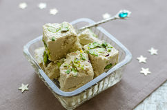 Halva pistachio on wooden table Royalty Free Stock Images