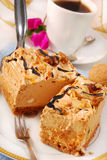 Halva taste cake. Two pieces of halva taste cake with almonds and walnuts Stock Photography
