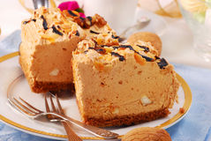 Halva taste cake. Two pieces of halva taste cake with almonds and walnuts Royalty Free Stock Photos