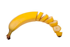 Halva unpeeled skivad banan - Arkivfoton