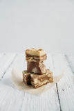 The halva on a white table. The halva dessert on white wooden table Royalty Free Stock Images