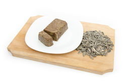 Halvah with sunflower seeds on wood planl Royalty Free Stock Photography
