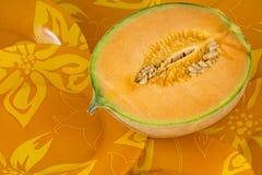 Halvan av en melon Arkivfoton
