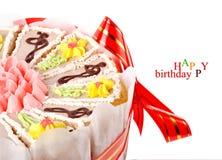 Halve cake op een witte achtergrond Stock Fotografie