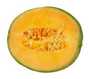 Halve meloen die op wit wordt geïsoleerdE stock foto's