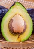 Halved avocado with core. Royalty Free Stock Photo