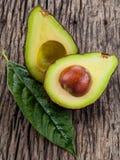 Halved avocado with core. Stock Photos