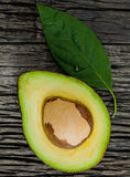 Halved avocado with core Stock Images