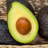 Halved avocado with core - Royalty Free Stock Images