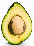 Halved avocado with core  on white Stock Images