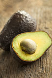 Halved avocado on old table Stock Image