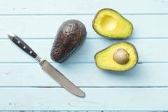 Halved avocado on table Stock Photo