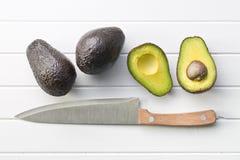 Halved avocado on table Royalty Free Stock Photo