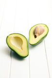 Halved avocados Stock Images