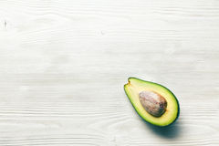 Halved avocados on wooden background Royalty Free Stock Photography