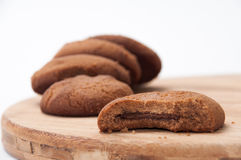 Halved biscuits with a few pieces in the background Stock Photos