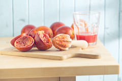 Halved blood orange and juicer Stock Photography