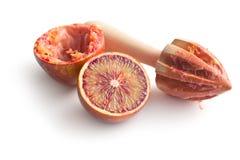Halved blood orange and juicer Royalty Free Stock Photo