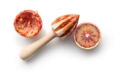 Halved blood orange and juicer Royalty Free Stock Images