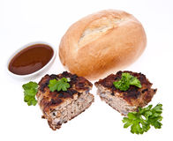 Halved burger with parsley isolated Stock Photography