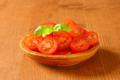 Halved cherry tomatoes Stock Images
