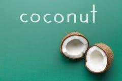 Halved coconut on chalkboard Stock Photography